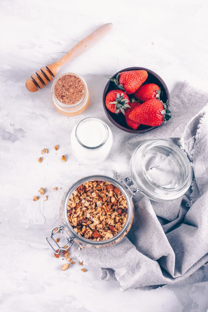 Homemade granola with yogurt, strawberries and honey from top view, above. Breakfast Diet Clean Food